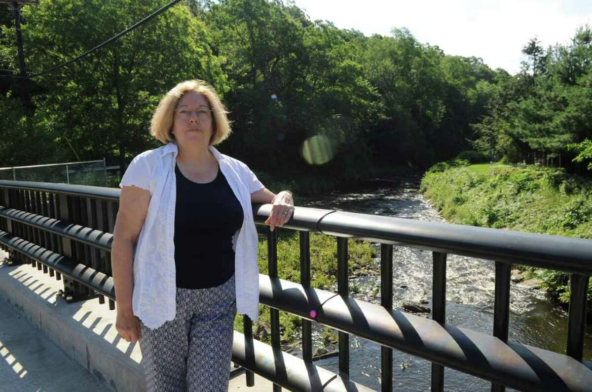 Denise Savageau, Greenwich conservation director, stands on the Comley Avenue Bridge where there is a stream gauge, on Wednesday, June 29, 2011. Savageau is concerned about recurring droughts in Greenwich.
