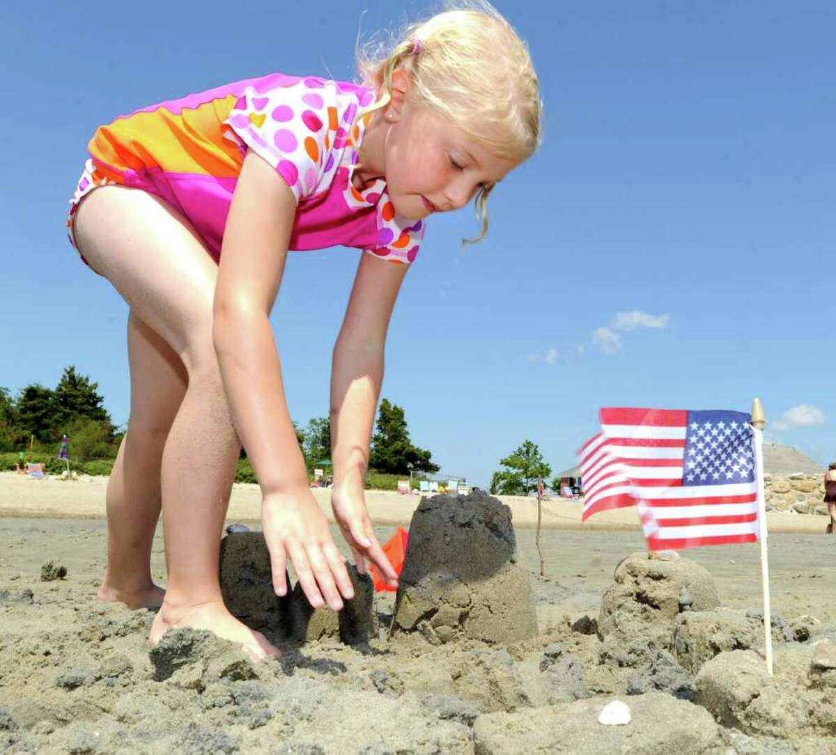 Cori Heyel, 8, of Fairfield, builds her sand castle during the Greenwich Arts Council's Sand Blast!, sand sculpture festival, at Greenwich Point Saturday, July 9, 2011.