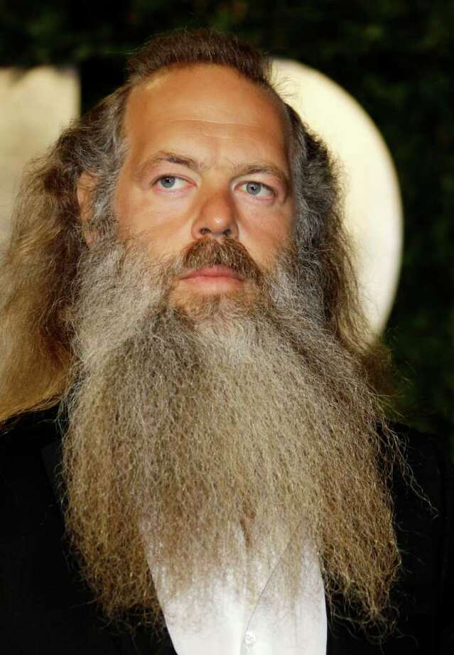 """FILE - In this Feb. 27, 2011 file photo, music producer Rick Rubin arrives at the Vanity Fair Oscar Party at the Sunset Tower in Los Angeles, Calif. Rubin, who produced several tracks on singer Adele's """"21"""" album credits her success to honest lyrics. (AP Photo/Carlo Allegri, file) Photo: Carlo Allegri"""