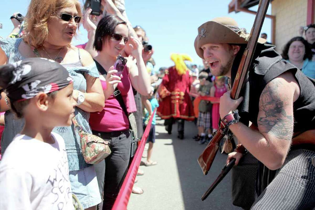 Pirates greet the crowd during the Seafair Pirates Landing at Alki Beach in Seattle on Saturday, July 9, 2011.