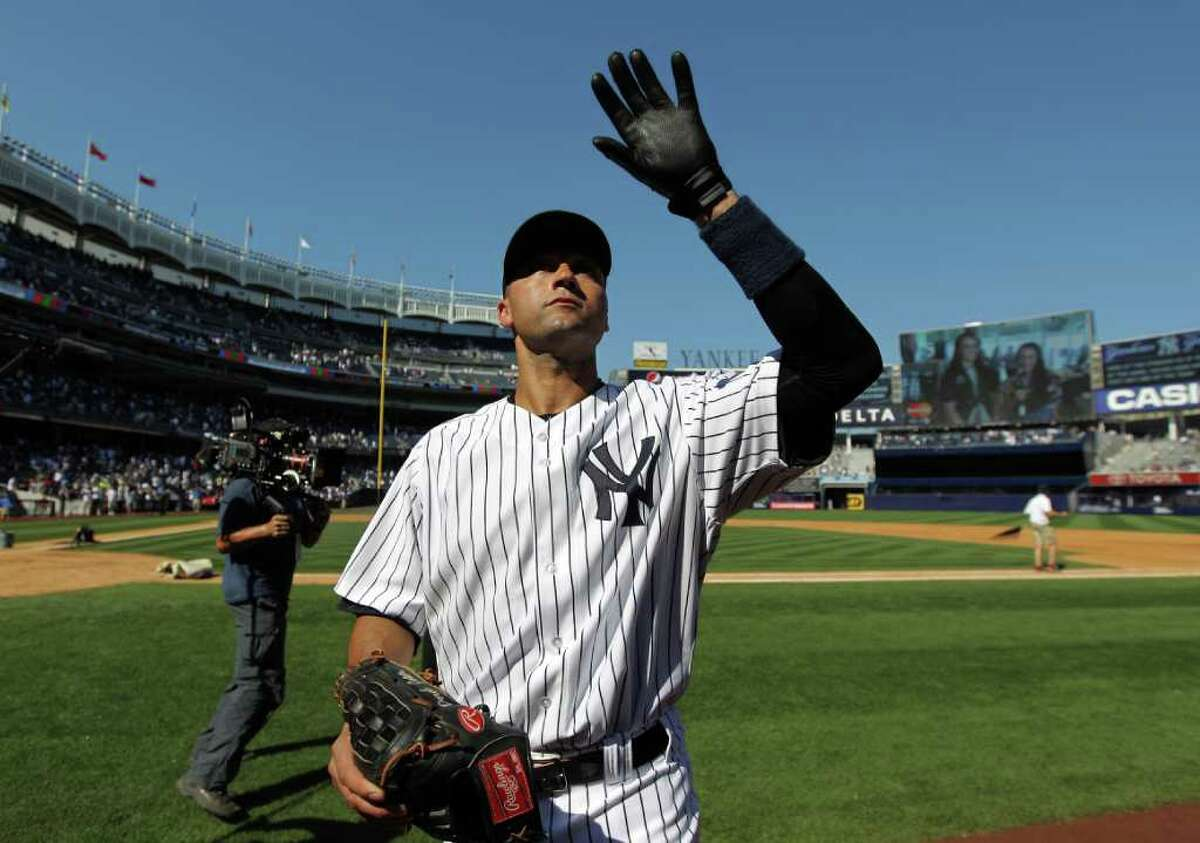 NEW YORK, NY - JULY 09: Derek Jeter #2 of the New York Yankees waves to the fans after a game against the Tampa Bay Rays at Yankee Stadium on July 9, 2011 in the Bronx borough of New York City. Jeter hit the 3000th hit of his career in the game. (Photo by Nick Laham/Getty Images)