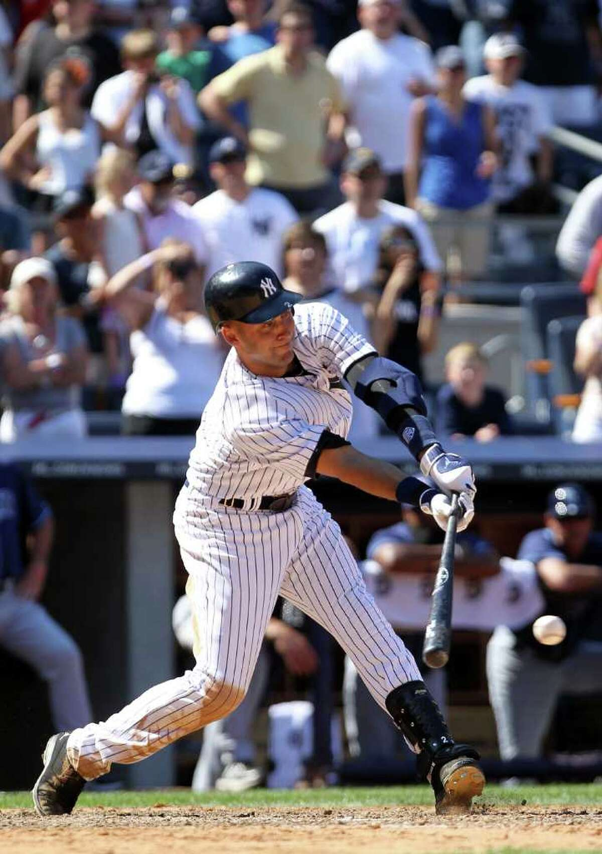 NEW YORK, NY - JULY 09: Derek Jeter #2 of the New York Yankees hits an RBI game winning single in the eighth inning against the Tampa Bay Rays at Yankee Stadium on July 9, 2011 in the Bronx borough of New York City. (Photo by Nick Laham/Getty Images)