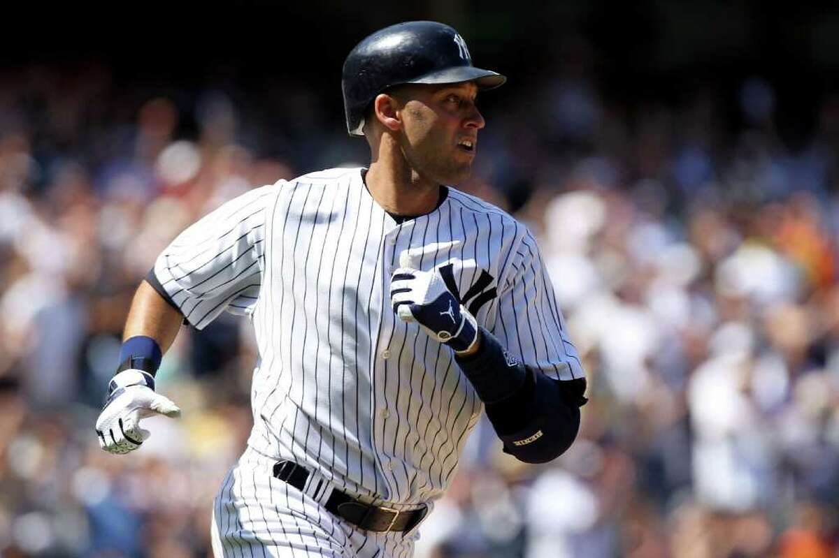 NEW YORK, NY - JULY 09: Derek Jeter #2 of the New York Yankees runs up the line after hitting a single in the sixth inning at Yankee Stadium on July 9, 2011 in the Bronx borough of New York City. (Photo by Nick Laham/Getty Images)