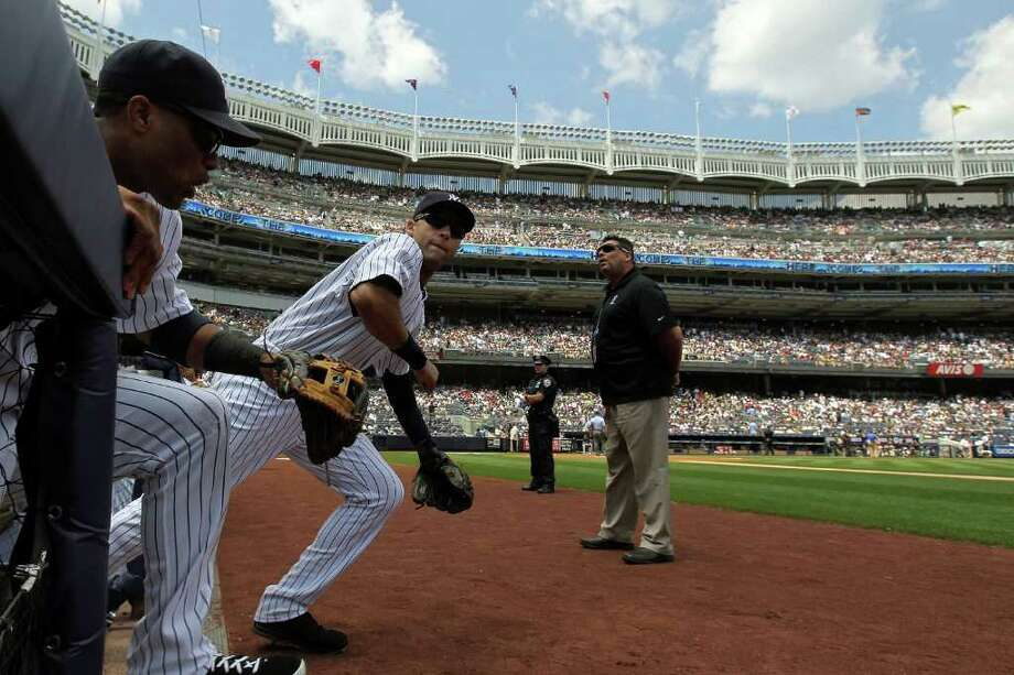 NEW YORK, NY - JULY 09:  Derek Jeter #2 of the New York Yankees takes the field at the start of a game against the Tampa Bay Rays at Yankee Stadium on July 9, 2011 in the Bronx borough of New York City.  (Photo by Nick Laham/Getty Images) Photo: Nick Laham, Getty Images / 2011 Getty Images