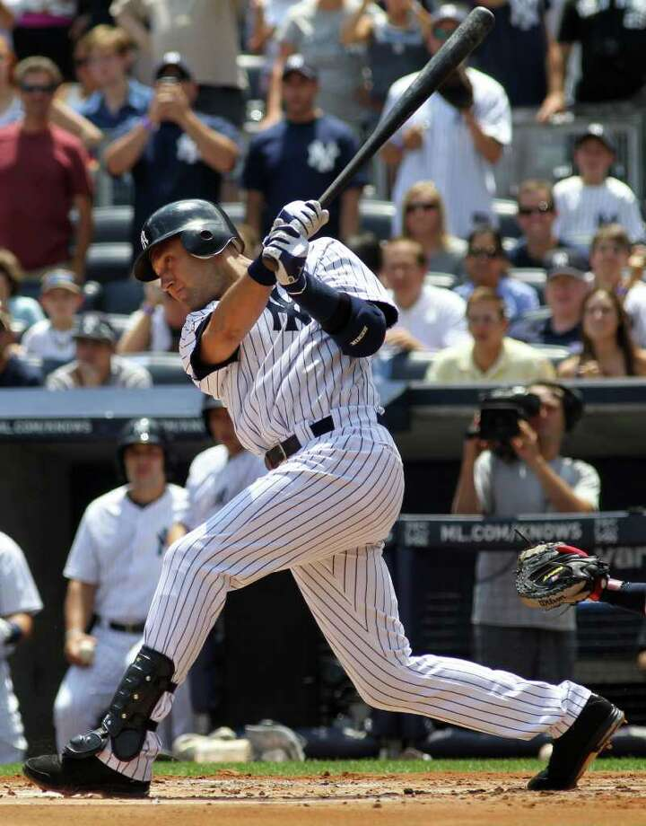 NEW YORK, NY - JULY 09:  Derek Jeter #2 of the New York Yankees hits a single for career hit 2999 while playing against the Tampa Bay Rays at Yankee Stadium on July 9, 2011 in the Bronx borough of New York City.  (Photo by Michael Heiman/Getty Images) Photo: Michael Heiman, Getty Images / 2011 Getty Images