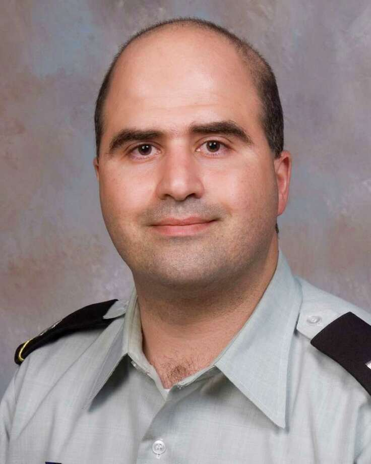 FILE - This 2007 file photo provided by the Uniformed Services University of the Health Sciences (USUHS) shows Maj. Nidal Malik Hasan when he undertook the Disaster and Military Psychiatry Fellowship program.  More than two dozen soldiers have testified in a senate investigation announced Saturday, July 9, 2011,  about the day they were shot in a crowded Fort Hood building in November 2009 by Hasan. (AP Photo/USUHS, File) Photo: HONS / Uniformed Services University of