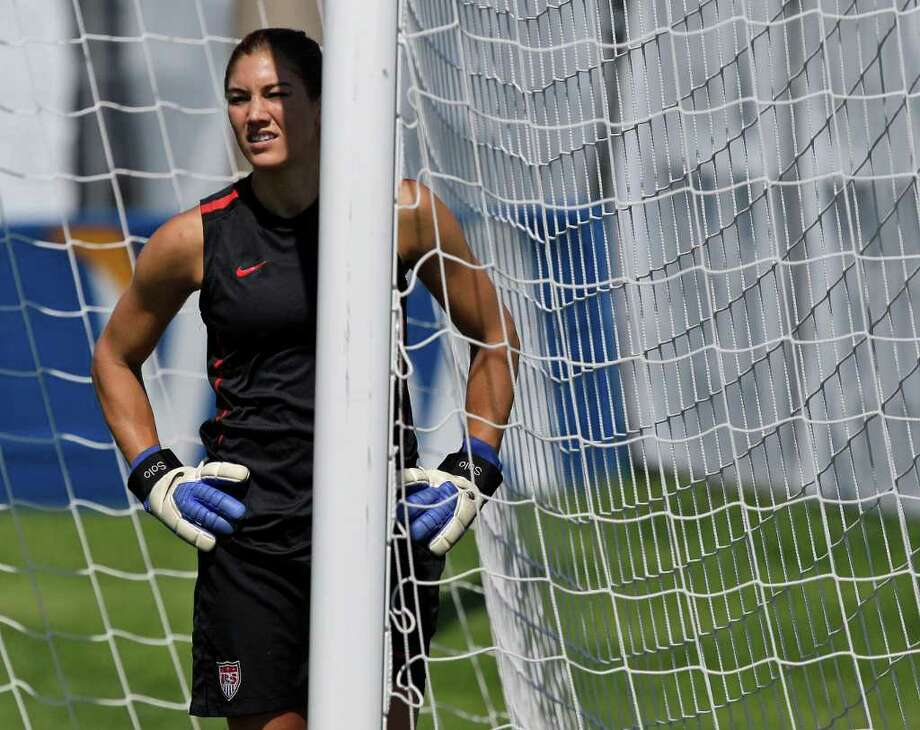 United States goalkeeper Hope Solo takes a break from a drill during a training session in preparation for a quarterfinal match against Brazil during the Women?s Soccer World Cup in Dresden, Germany, Saturday, July 9, 2011. (AP Photo/Marcio Jose Sanchez) Photo: Marcio Jose Sanchez, STF / AP