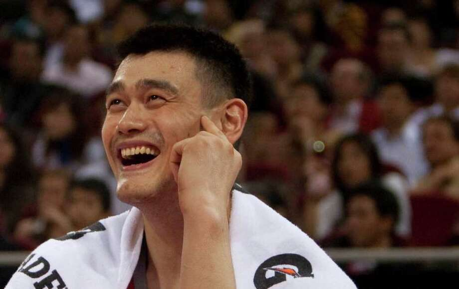Houston Rockets center Yao Ming smiles big in the fourth  quarter of the  Houston Rockets and New Jersey Nets preseason match-up at Wukesong Arena in Beijing, China, Wednesday, October 13, 2010. The Preseason game in Beijing is one of two games the Rockets will play in China as part of the China Games. The Rockets went on to beat the Nets 91-81.  (Billy Smith II / Chronicle) Photo: Billy Smith II, HC Staff / Houston Chronicle