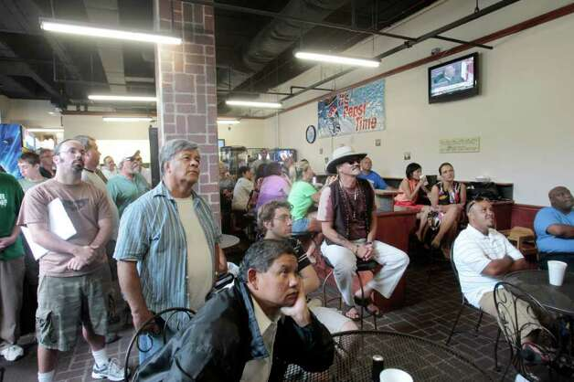 Local residents and visitors watch Judge Belvin Perry on television during the Casey Anthony sentencing in a cafeteria next to the Orange County Courthouse in Orlando, Fla., Thursday, July 7,  2011. A court official says Casey Anthony is going to be released from jail next Wednesday following her conviction for lying to authorities who were investigating the death of her 2-year-old daughter, Caylee. (AP Photo/Alan Diaz) Photo: Alan Diaz
