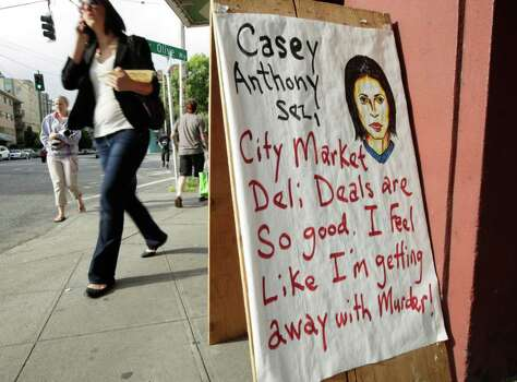 A sign at a deli in Seattle's Capitol Hill neighborhood makes reference to the first-degree murder acquittal in the Casey Anthony murder trial, Thursday, July 7, 2011, in Seattle. (AP Photo/Ted S. Warren) Photo: Ted S. Warren