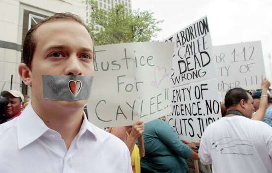 Edward Mehnert, of Orlando, covers his mouth with duct tape as he protests during the Casey Anthony sentencing in outside the Orange County Courthouse in Orlando, Fla., Thursday, July 7,  2011. A court official says Casey Anthony is going to be released from jail next Wednesday following her conviction for lying to authorities who were investigating the death of her 2-year-old daughter,  Caylee. (AP Photo/Alan Diaz) Photo: Alan Diaz