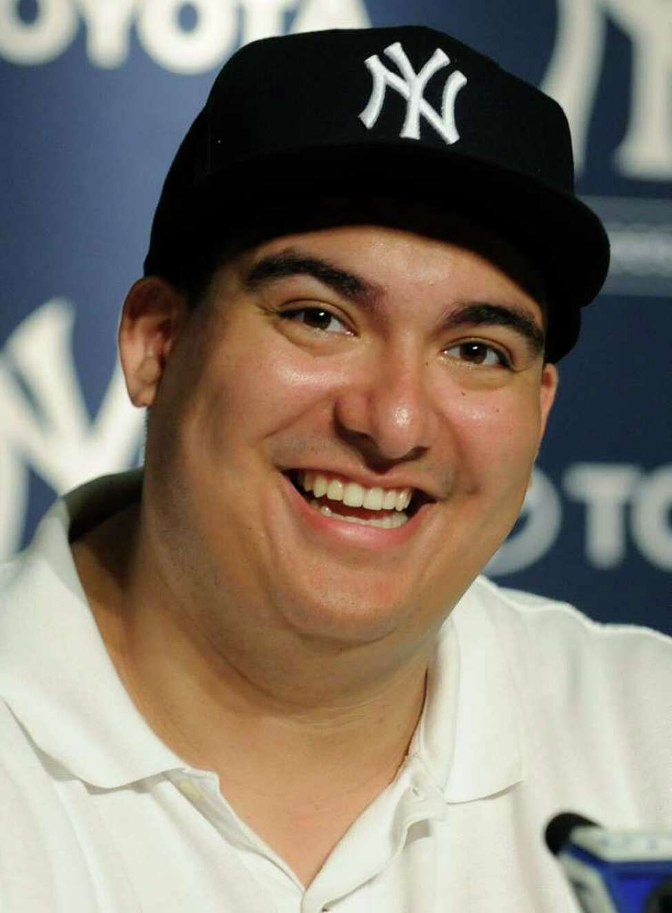 Christian Lopez smiles during a news conference after catching the 3,000th career hit by New York Yankees' Derek Jeter in the third inning of a baseball game against the Tampa Bay Rays, Saturday, July 9, 2011, at Yankee Stadium in New York. (AP Photo/Bill Kostroun)