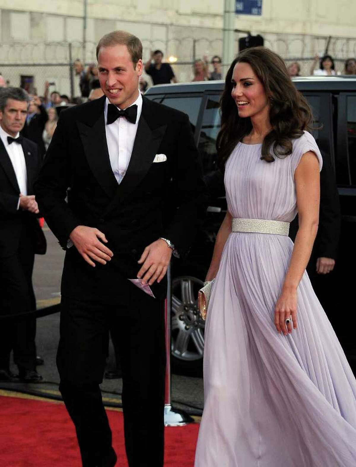 Prince William, Duke of Cambridge (L) and Catherine, Duchess of Cambridge arrive.
