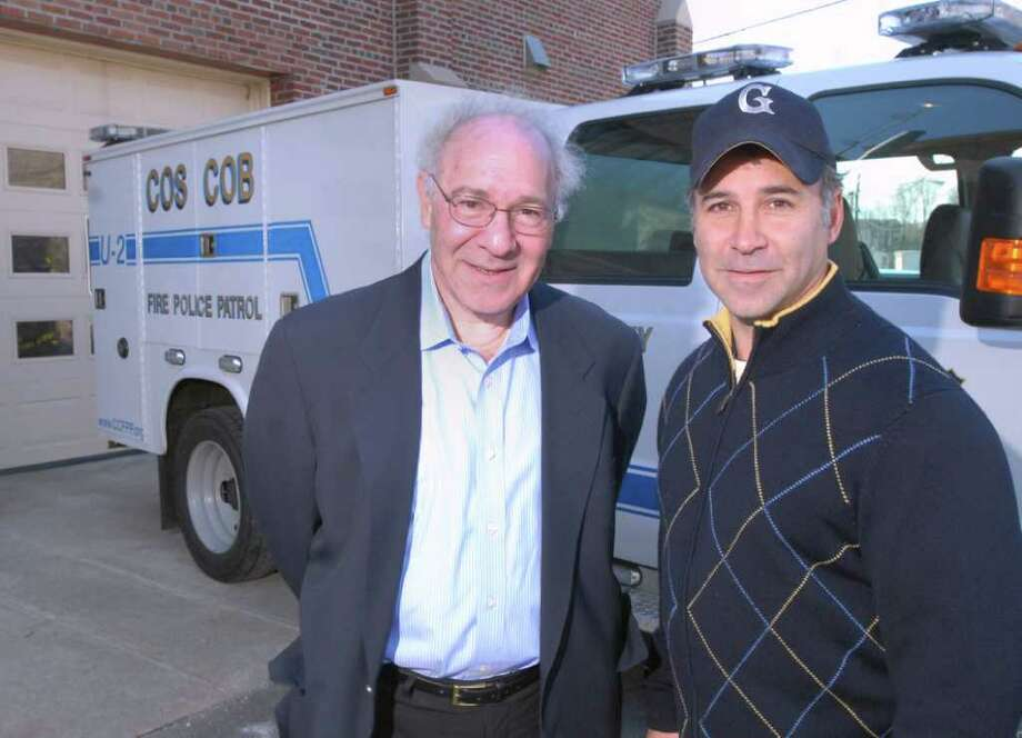 Joe Kaliko, left, president of the Cos Cob Fire Police Patrol, and State Rep. Alfred Camillo, R-151st District, in front of the Cos Cob Fire Station on Feb. 19, 2011. Camillo has proposed a bill that would give volunteer firefighters the same legal protection that municipalities extend to professinal firefighters. Photo: File Photo / Greenwich Time File Photo