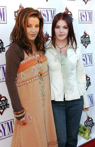 Mother and daughter Lisa Marie Presley, left, and Priscilla, right. Photo: RENE MACURA/STR, AP / AP