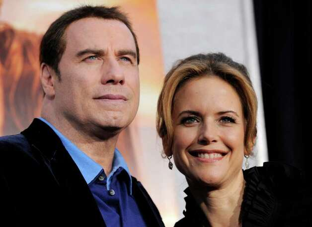 John Travolta and Kelly Preston Photo: AP