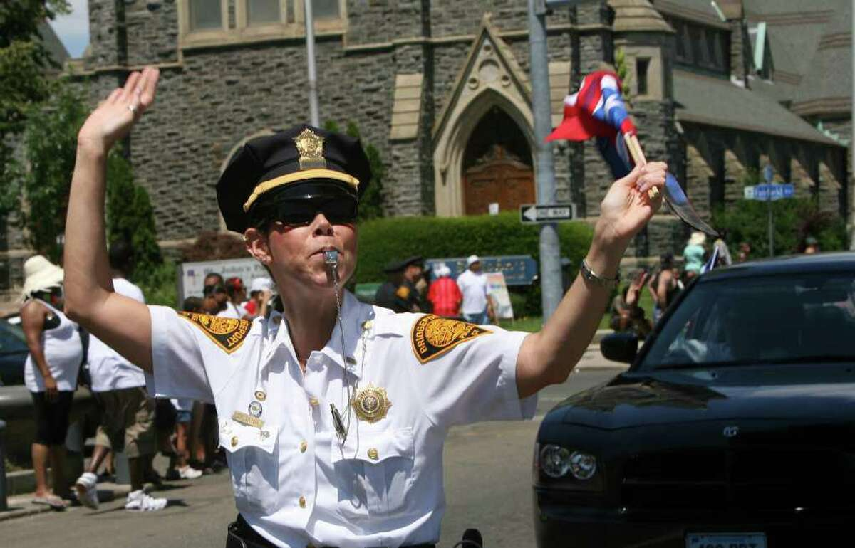 Bridgeport Lt Rebecca Garcia cheers the crowd at the 18th annual Puerto Rican Day Parade in Bridgeport on Sunday, July 10, 2011.