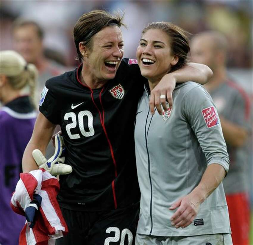 United States' Abby Wambach, left, and United States goalkeeper Hope Solo celebrate winning the the quarterfinal match between Brazil and the United States at the Women�s Soccer World Cup in Dresden, Germany, Sunday, July 10, 2011. (AP Photo/Marcio Jose Sanchez)