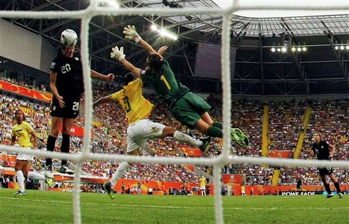 United States' Abby Wambach scores her side's 2nd goal during the quarterfinal match between Brazil and the United States at the Women�s Soccer World Cup in Dresden, Germany, Sunday, July 10, 2011. (AP Photo/Marcio Jose Sanchez)