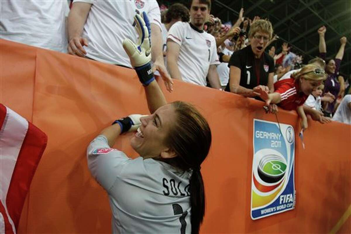 United States goalkeeper Hope Solo celebrates winning the quarterfinal match between Brazil and the United States at the Women�s Soccer World Cup in Dresden, Germany, Sunday, July 10, 2011. (AP Photo/Marcio Jose Sanchez)