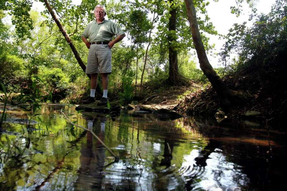 "Waller County resident Tom Brown who lives along Clear Creek said he's afraid he's going to lose all the beauty that surrounds his 30-acres where he retired after living in Houston because of the proposed landfill and industrial park that is proposed across the street from his property about a mile north of Hempstead along Hwy. 6, Wednesday, July 6, 2011, in Hempstead.  A Georgia-based company plans to build a mixed-use industrial facility including a landfill that residents say will be used for Harris County trash. His main concern is the landfills proximity to Clear Creek, which he says could contaminate the Brazos River and some communities water supply. ""I come here some days and pray the rosary. You can't hear any thing but the water running,"" Brown said. ""But if this landfill goes in it will all change."" ( Johnny Hanson / Houston Chronicle ) Photo: Johnny Hanson, Staff / © 2011 Houston Chronicle"