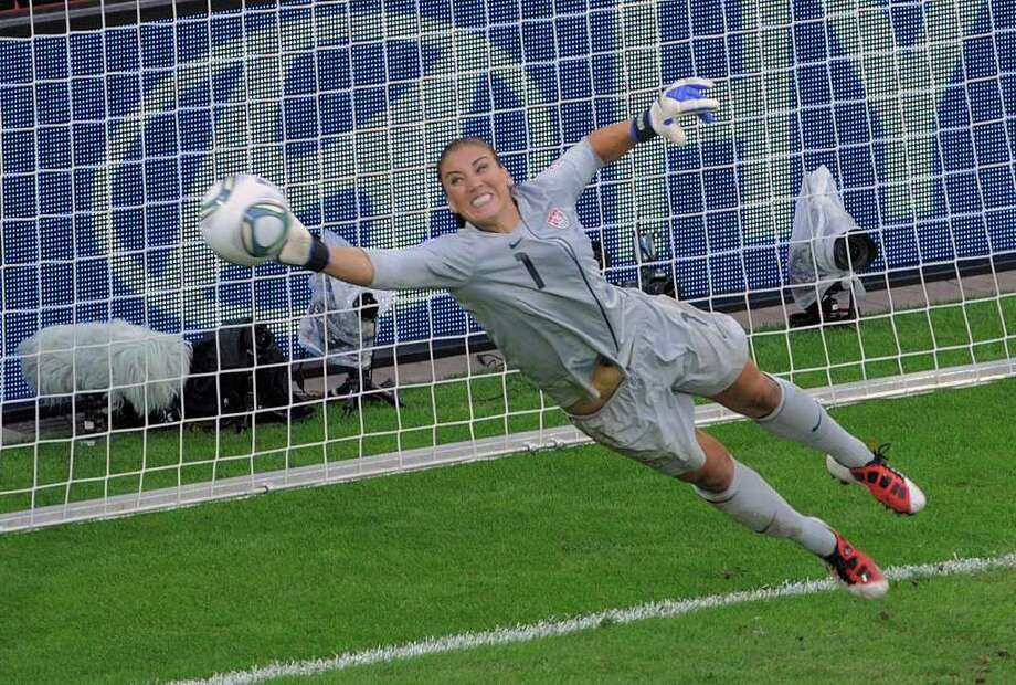 United States goalkeeper Hope Solo deflects a penalty shot during the quarterfinal match between Brazil and the United States at the Womenís Soccer World Cup in Dresden, Germany, Sunday, July 10, 2011. (AP Photo/Jens Meyer) Photo: Jens Meyer, STR / AP