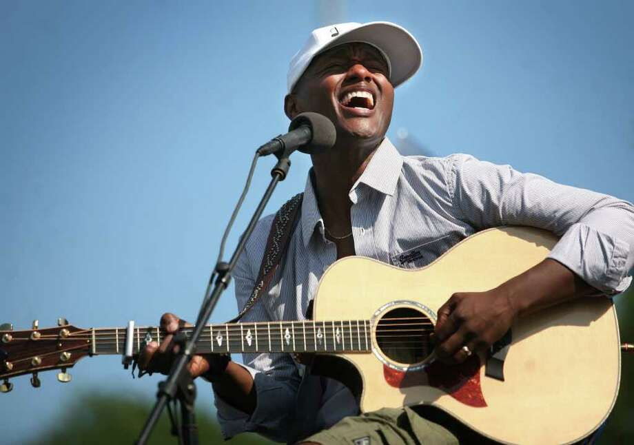 "Javier Colon, Stratford native and winner of the television singing competition ""The Voice"", performs for a welcome home celebration at Bunnell High School in Stratford on Sunday, July 10, 2011. Photo: Brian A. Pounds / Connecticut Post"