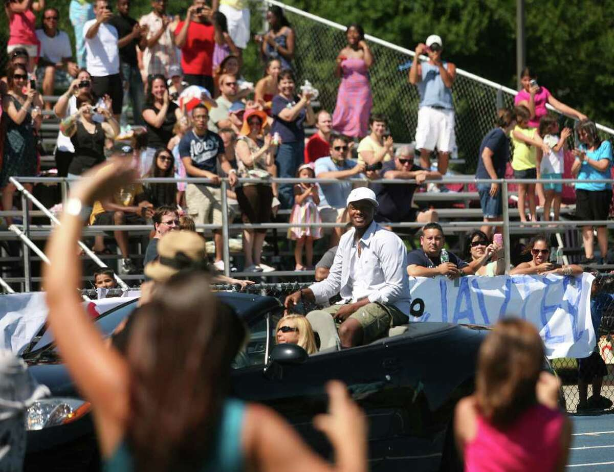 """Javier Colon, Stratford native and winner of the television singing competition """"The Voice"""", is greeted by fans a welcome home celebration at Bunnell High School in Stratford on Sunday, July 10, 2011."""