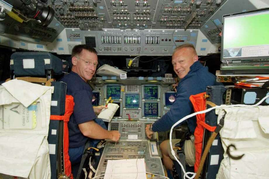 IN SPACE - JULY 9:  In this handout image provided by the National Aeronautics and Space Administration (NASA), NASA astronauts Chris Ferguson (L) and Doug Hurley are pictured at the commander's station and pilot's station, respectively, on the flight deck of the Earth-orbiting NASA space shuttle Atlantis on the second day of activity July 09, 2011 in space. Atlantis has embarked on a 12-day mission to the International Space Station where it will deliver the Raffaello multi-purpose logistics module packed with supplies and spare parts. This will be the final launch of the space shuttle program, which began on April 12, 1981 with the launch of Colombia.  (Photo by NASA via Getty Images) Photo: NASA, Handout / 2011 NASA