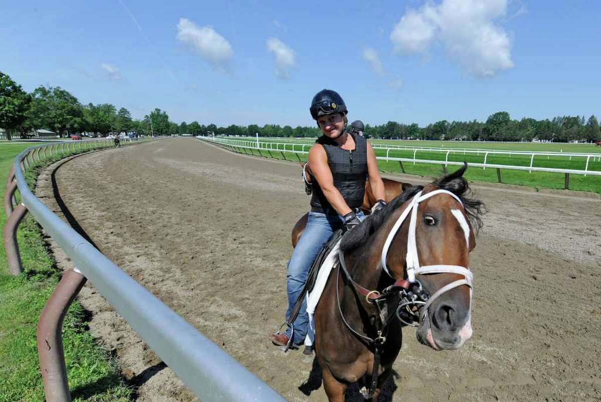 Photographer Heater Coots, on horseback at the Oklahoma Training Center in Saratoga Springs, N.Y. July 7, 2011, whose work will be park of a coming show