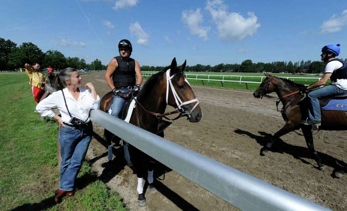 Photographer Dona Ann McAdams speaks with one of her photography students Heater Coots, on horseback at the Oklahoma Training Center in Saratoga Springs, N.Y. July 7, 2011, about their coming show
