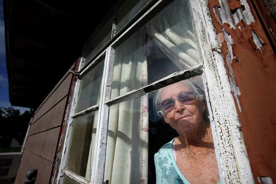 South Side resident Sue Hulbert, 87, had to wait 10 months before weatherization on her home was done through the Alamo Area Council of Governments. She's satisfied with the work but says the improvements should have included new windows. Photo: Kin Man Hui/kmhui@express-news.net / San Antonio Express-News
