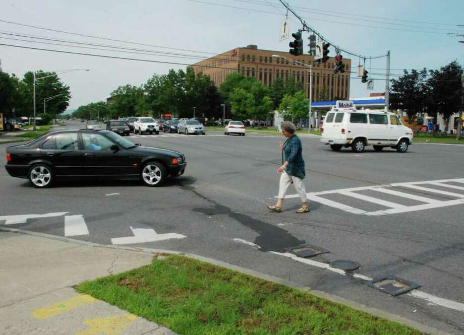 JoEllen puts her hand up to stop a driver from turning into her path on Wolf Road in Colonie, N.Y., July 8, 2011. (Yi-Ke Peng / Times Union) Photo: Yi-Ke Peng