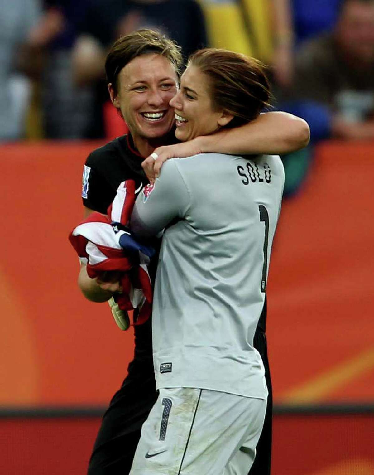DRESDEN, GERMANY - JULY 10: Hope Solo of USA (R) celebrates with Abby Wambach after victory in the penalty shoot out during the Women's World Cup Quarter Final match between Brazil and USA at Rudolf-Harbig Stadium on July 10, 2011 in Dresden, Germany. (Photo by Scott Heavey/Getty Images)