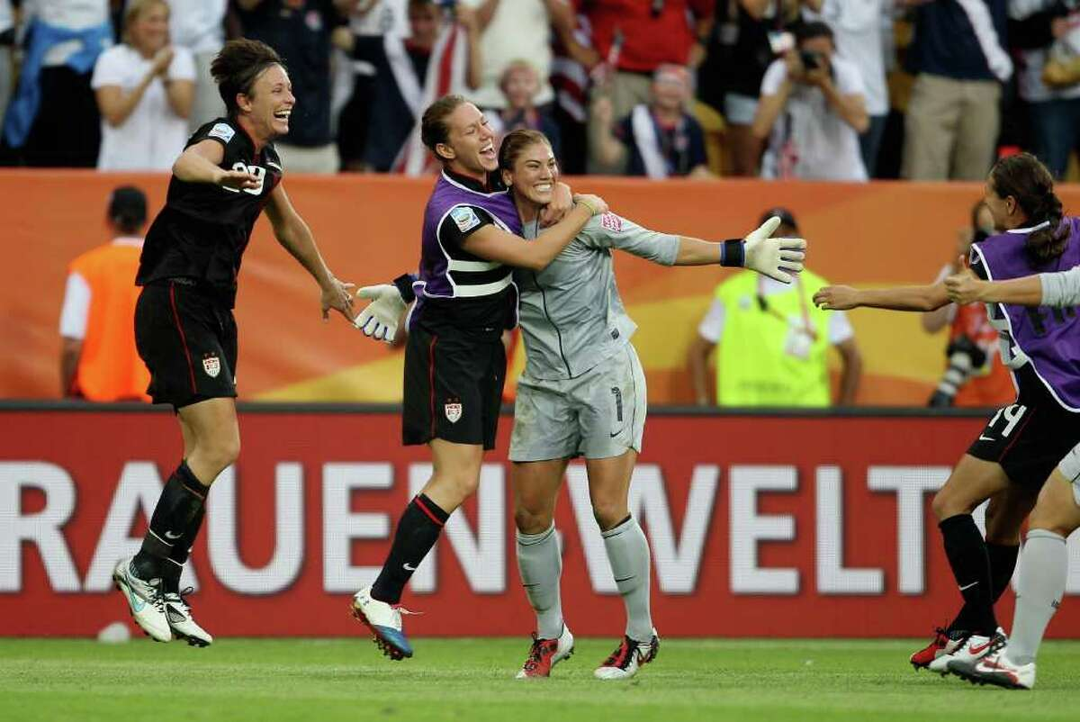 DRESDEN, GERMANY - JULY 10: Hope Solo of USA celebrates after saving a penalty in the shoot out during the Women's World Cup Quarter Final match between Brazil and USA at Rudolf-Harbig Stadium on July 10, 2011 in Dresden, Germany. (Photo by Scott Heavey/Getty Images)