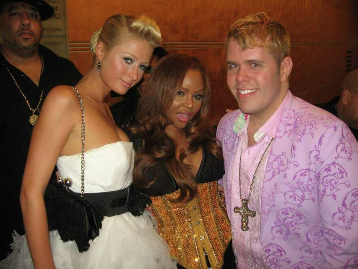 This photo provided by Perez Hilton, shows blogger Perez Hilton, right, with celebrities Paris Hilton, left, and Lil' Kim at the MTV Music Video Awards in New York in Aug. 2006. Perez Hilton, whose Web site has become a go-to source for juicy celebrity dish, says he knows his place in the bold-faced world. It's outside looking in.