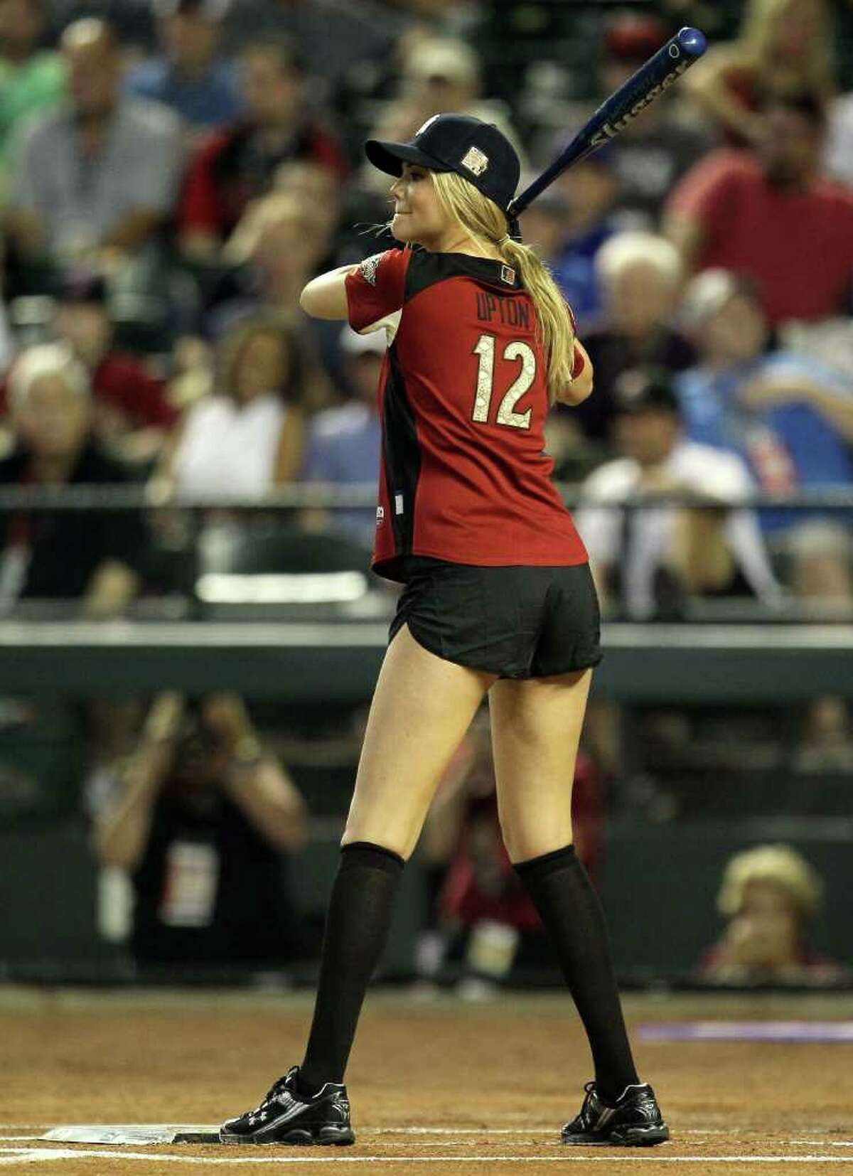 PHOENIX, AZ - JULY 10: Model Kate Upton takes an at bat during the 2011 Taco Bell All-Star Legends & Celebrity Softball Game at Chase Field on July 10, 2011 in Phoenix, Arizona. (Photo by Jeff Gross/Getty Images)