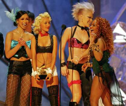"LOS ANGELES - FEBRUARY 27:  American pop stars Christina Aguilera, ""Mya"", ""Lil Kim"" and ""Pink"" perform on stage at the 44th Grammy Awards 2002 on February 27, 2002 in Los Angeles, United States. Photo: Dave Hogan, Getty Images / 2002 Getty Images"