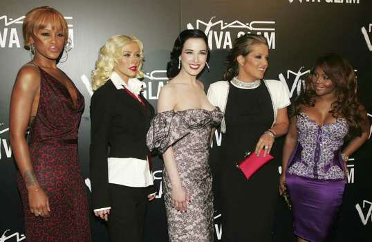 NEW YORK - SEPTEMBER 06:  (L-R) Singers Eve, Christina Aguilera, Dita von Teese, Lisa Marie Presley and Lil' Kim attend the M.A.C. Viva Glam VI dinner to benefit Aids research at Cedar Lake on September 6, 2006 in New York City. Photo: Peter Kramer, Getty Images / 2006 Getty Images