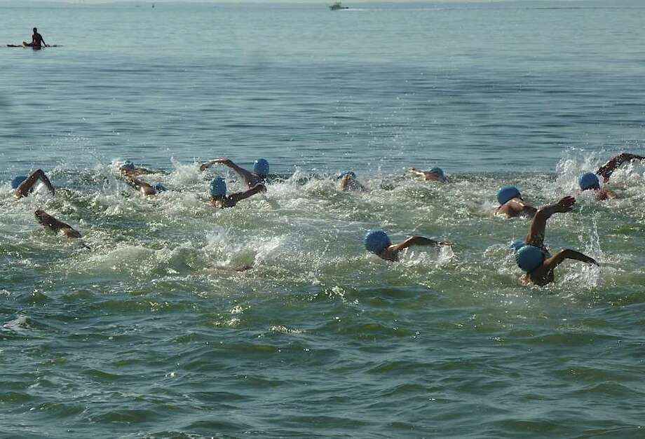 Nearly 200 swimmers competed in the mile-long Point-to-Point Swim, sponsored by the Westport Weston Family Y, on Sunday at Compo Beach. Photo: Contributed Photo/Mike Lauterborn, Contributed Photo / Westport News contributed