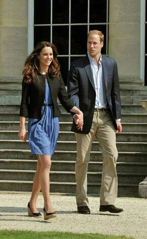 On the morning after her wedding, the Duchess emerged in this casual blue Zara dress and a favorite pair of espadrille wedges.  Photo: WPA Pool, Getty Images / 2011 Getty Images