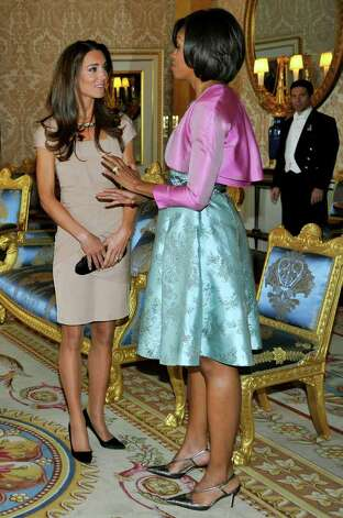 Post-honeymoon, Kate chatted with First Lady Michelle Obama in a flattering beige sheath from Reiss. The dress immediately sold out around the world.  Photo: WPA Pool, Getty Images / 2011 Getty Images