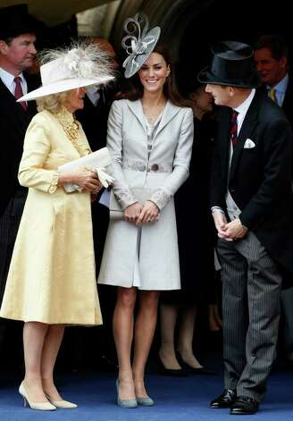 At the Order of the Garter service, Kate chose a monochromatic, dove-grey ensemble topped with a magnificent Philip Treacy fascinator.  Photo: WPA Pool, Getty Images / 2011 Getty Images