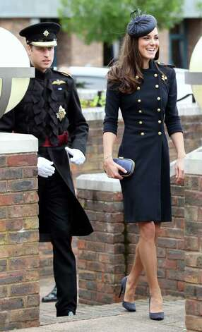 The Duchess joined her husband to present service medals to members of the Irish Guard. Appropriately, she paired her military-inspired coat with a golden shamrock brooch.  Photo: Chris Jackson, Getty Images / 2011 Getty Images