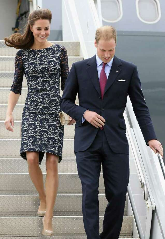 The Duchess stepped off the plane in Canada looking radiant in this lace overlay dress by Erdem.  Photo: Chris Jackson, Getty Images / 2011 Getty Images