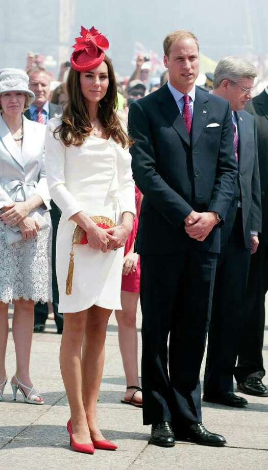 The Duchess didn't abandon her standout fascinators completely on the North American tour, choosing this maple leaf-inspired topper for the Canada Day celebrations. Even when she's essentially dressed as an Canadian flag, Kate still looks chic.  Photo: WPA Pool, Getty Images / 2011 Getty Images