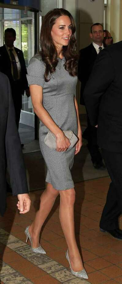 Stepping out again in Canada, Kate accented her monochromatic look with sparkling silver pumps.  Photo: Chris Jackson, Getty Images / 2011 Getty Images