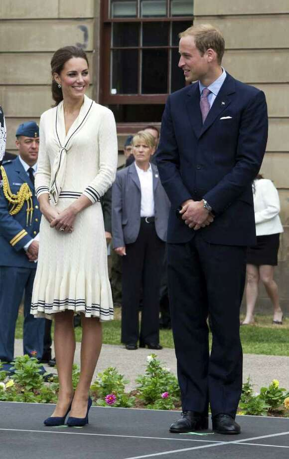 Kate chose this cable-knit Alexander McQueen dress for a visit to Charlottesville, Canada. The duchess is one of the designer's biggest fans -- she also chose a McQueen gown designed by Sarah Burton for her wedding day.  Photo: Pool, Getty Images / 2011 Getty Images