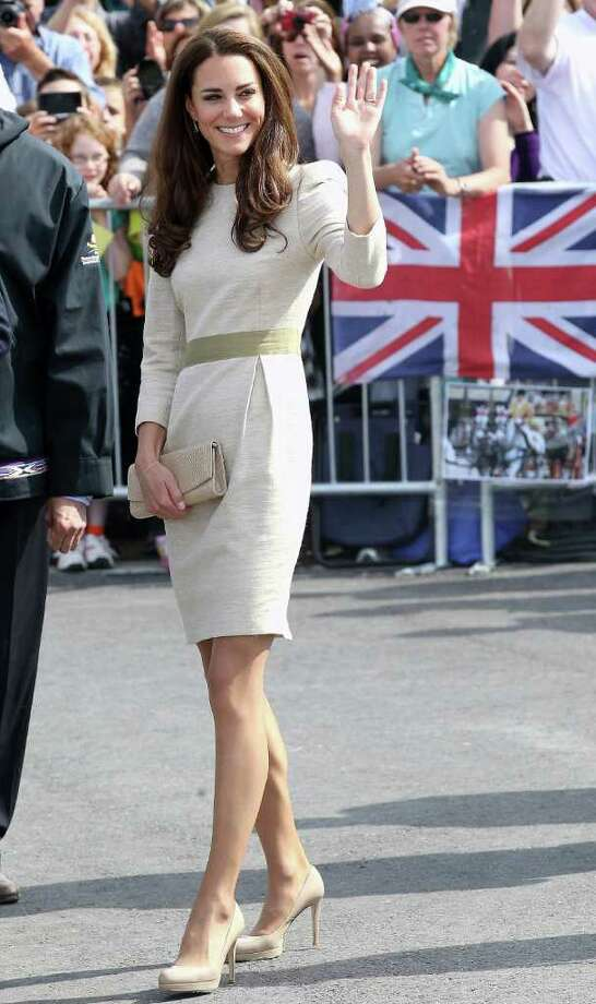 The duchess looked picture-perfect in this cream ensemble, accented by a sage green waistband.  Photo: Chris Jackson, Getty Images / 2011 Getty Images