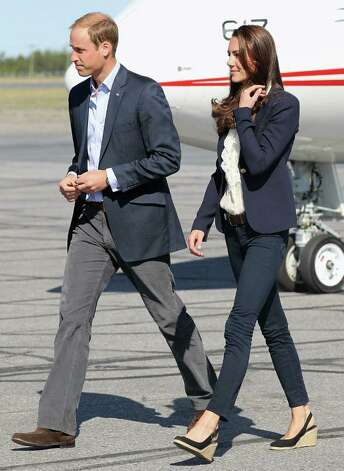 Kate paired her trusty Smythe blazer with a ruffled top and J. Brand jeans for another day of travel with husband William. The duchess' chic espadrille slingbacks reflect her love of High Street fashion -- they're by Nine West! Photo: Chris Jackson, Getty Images / 2011 Getty Images